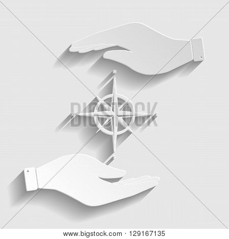 Wind rose sign. Save or protect symbol by hands. Paper style icon with shadow on gray.