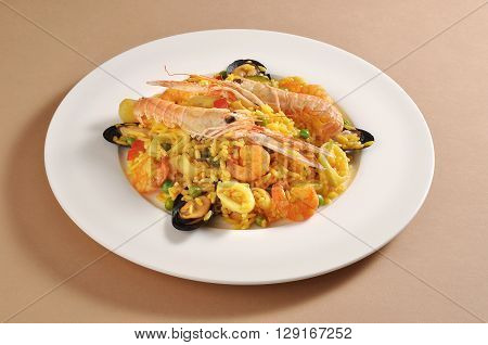 Dish with a portion of fish paella