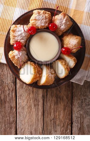 Fried Milk And Condensed Milk With Cherries Close-up. Vertical Top View