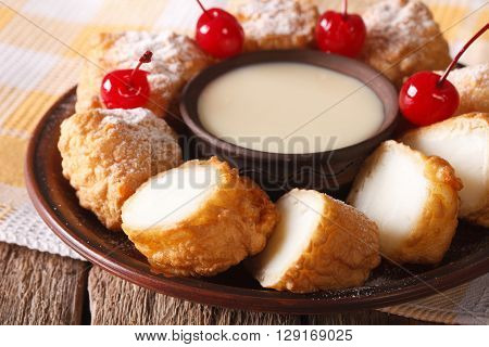 Dessert Leche Frita With Condensed Milk And Cherries Closeup. Horizontal