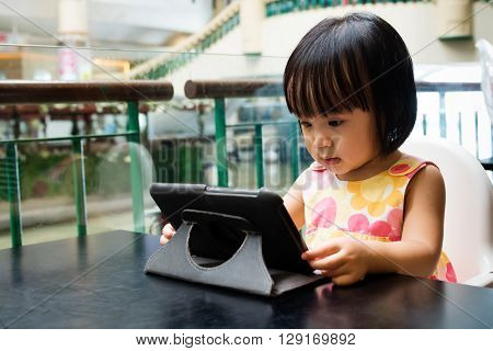 Asian Little Chinese Girl Looking At Digital Tablet