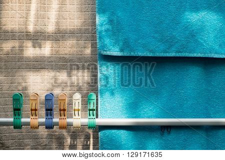 Colorful clothespin and towels on the clothesline.