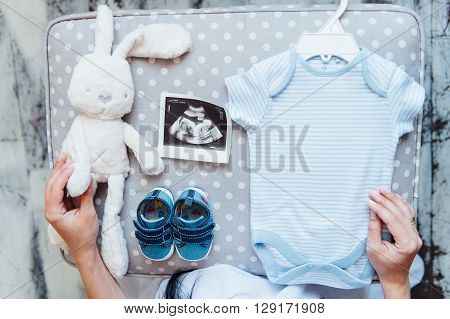Newborn Baby Clothes On Textile Background
