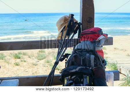 Equipment for hiking on the veranda overlooking the sea. Rest after a trekking. Windy sunny day in Cyprus Akamas Peninsula.