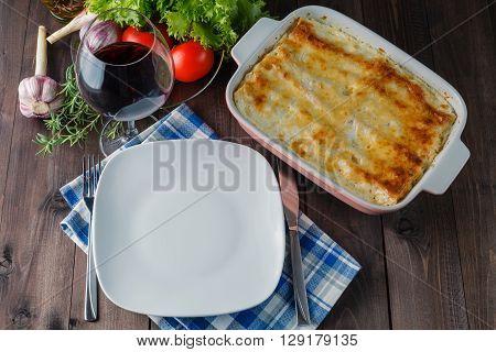 Fresh Prepared Lasagne With Ingredients On Table