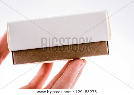 Hand holding cardboard Box on a white background