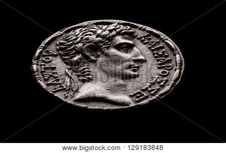 Ancient Roman silver coin of emperor Augustus macro selective focus