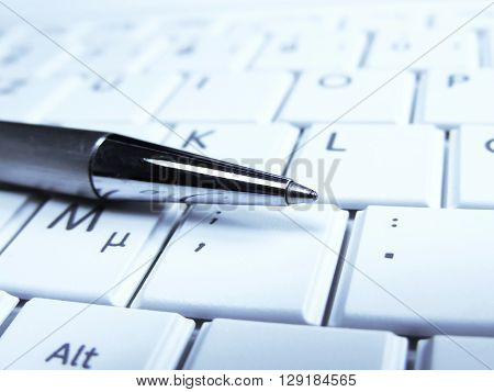 Pen and computer keypad, close-up. Business concepts.