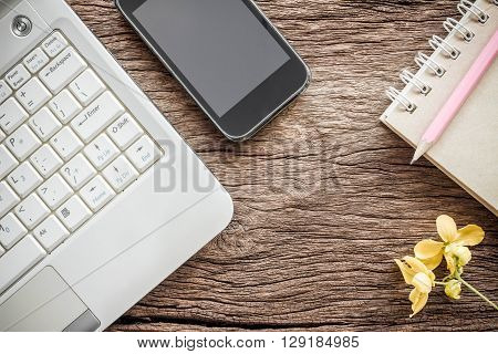 Working space. Laptop notebook smartphone on wooden desk. business concept.