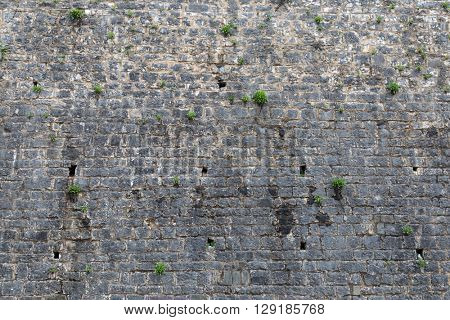 Aged stone tile wall texture