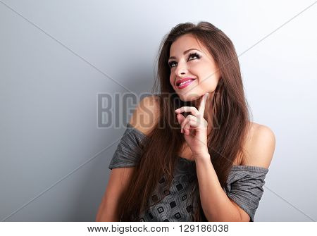 Thinking Fashion Young Female Model Looking Up On Empty Copy Space Background