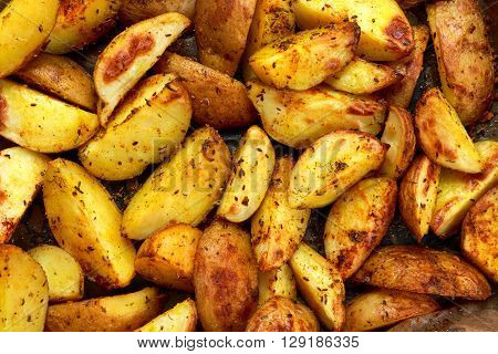 Roasted potatoes with rosemary and spices. Ready to eat. Background, texture.