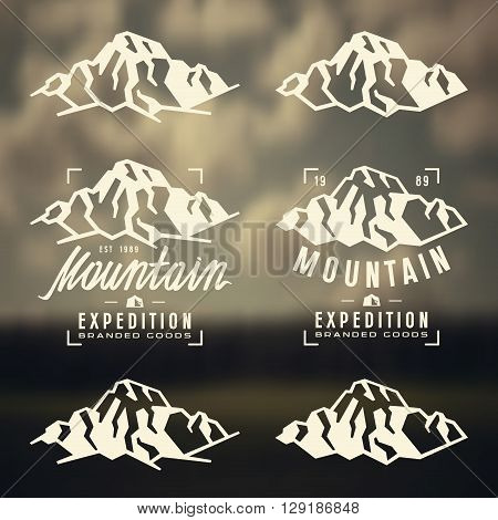 Mountain expedition labels badges and design elements. White print on blurred background