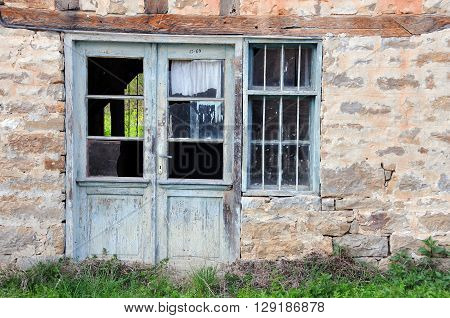 VETRINTSI VILLAGE, BULGARIA - MARCH 28, 2016; Abandoned building in the springtime