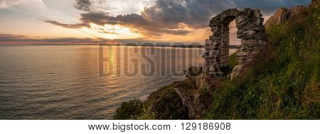 Beautiful sunset at cape Kaliakra and doorway as part of the remains of the fortress - copy space