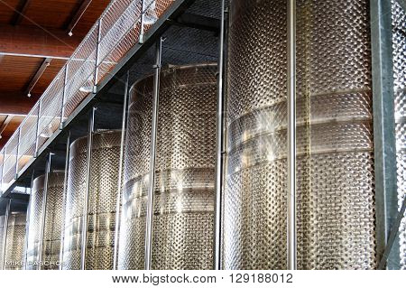 Big stainless steel tanks used by wineries and breweries for fermentation or storage.