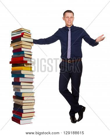 Young student telling about education process and stands in free pose beside pile of books, isolated on white background.