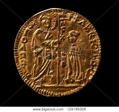 Gold coin of medieval Venice ducat reverse macro shot