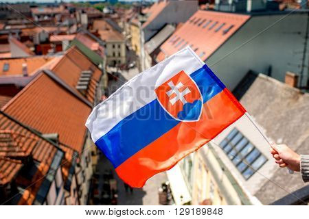 Slovak flag on the old town background in Bratislava the capital of Slovakia