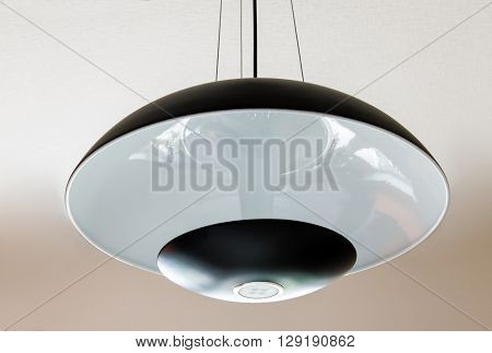 Ceiling lamp with glass shade round shape in black-and-white design.