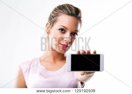 Woman (in Focus) Holding A Mobile Phone (out Of Focus)