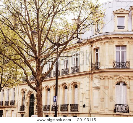 houses on french streets of Paris. citylife concept. spring warm sunlight
