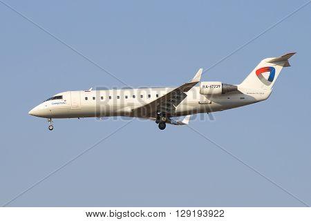 SAINT PETERSBURG, RUSSIA - MARCH 28, 2016: Aircraft Bombardier CRJ-200LR ( RA-67239) aviation enterprise