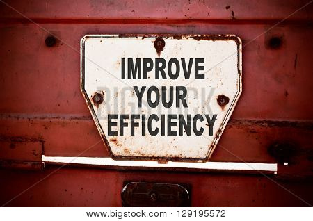 Improve Your Efficiency. Message text written on iron board