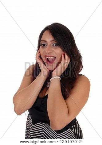 A pretty East Indian woman laughing with her mouth open standing in a portrait image isolated for white background.
