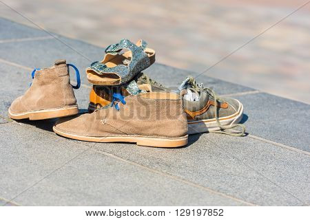 Family Shoes Left On A Pavement