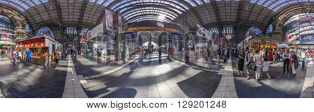 Travelers Walk Among The Kiosks And The Departure Gates At Frankfurt Train Station