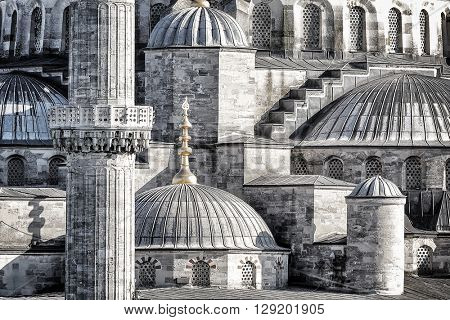 Closeup photo of a beautiful Blue Mosque background, details of an exterior of an ancient architectural masterpiece, black and white photo, Istanbul, Turkey