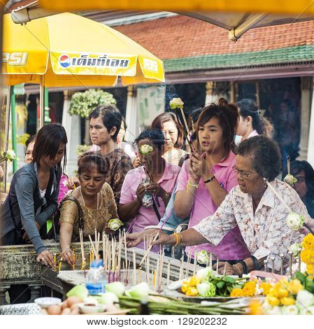 People Enjoy Offerings At The Grand Palace In Bangkok