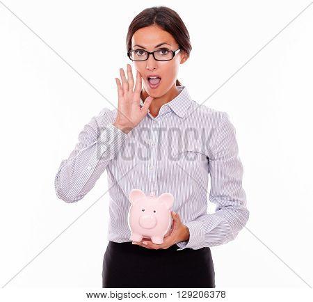 Calling Businesswoman Holding Pink Piggy Bank