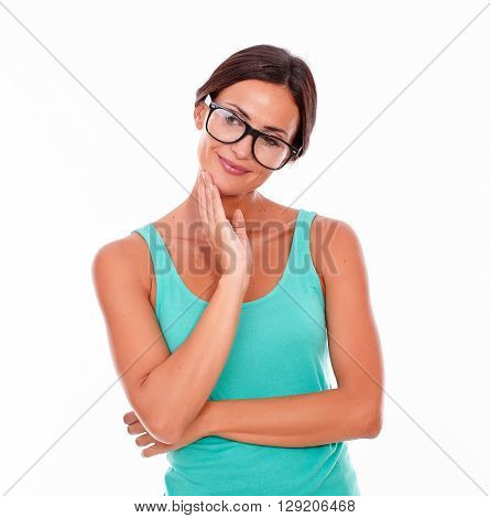 Contemplating Brunette Woman With Green Tank Top