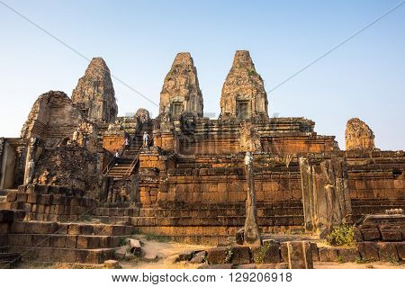 Phnom Bakheng at Angkor Cambodia is a Hindu and Buddhist temple in the form of a temple mountain dedicated to Shiva