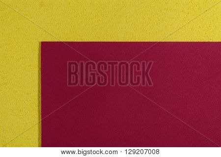 Eva foam ethylene vinyl acetate smooth red surface on lemon yellow sponge plush background