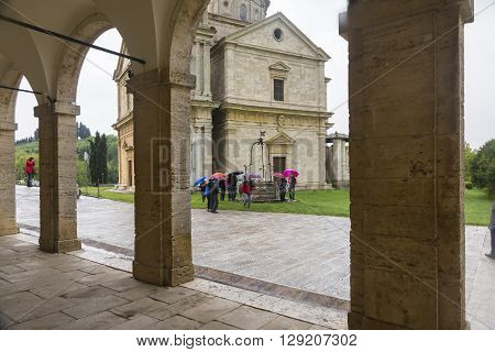 MONTEPULCIANO,ITALY-APRIL 23,2016:people stroll and take photograph under the umbrella in Saint Biagio church in MontepulcianoItaly during a cloudy day.