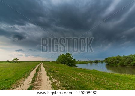 Ominous stormy sky over natural wild river