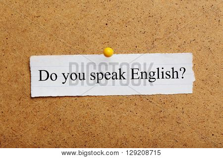 Sheet of paper on brown wooden background, do you speak english