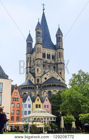Cologne, Germany - May 16: This is quay of the left bank of the Rhine near the Fish Market and the church of St. Martin at foggy evening May 16, 2013 in Cologne, Germany.