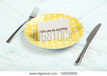 Yellow plate on a blue wooden table, you can do anything