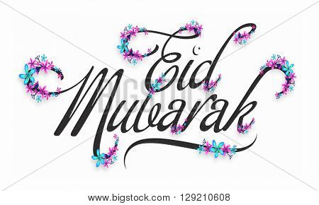Colourful flowers decorated beautiful text Eid Mubarak on white background for Muslim Community Festival celebration.