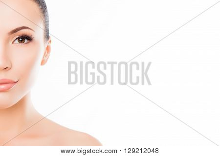Half-face Portrait Of Beautiful Sensitive Woman On White Background