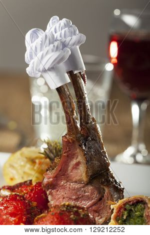 grilled lamb on a plate with wine