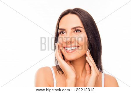 Closeup Portrait Of Tender Attractive Young Woman Touching Her Face