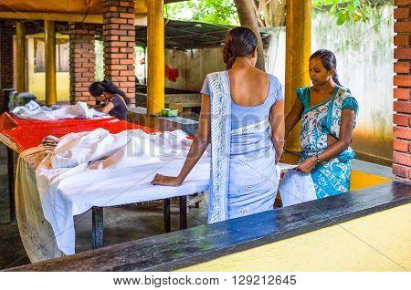 Sigirija Sri Lanka - December 8 2012: Young skilled craftsman in a small batik workshop