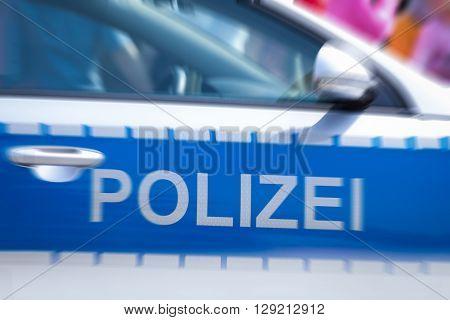 german police car door with zoom effect