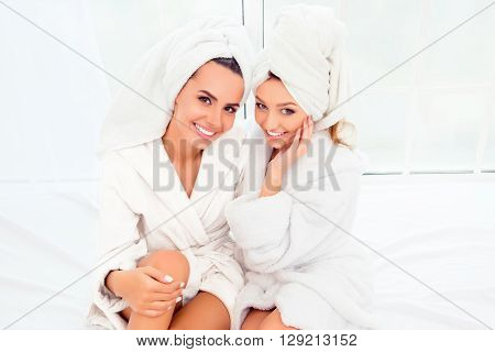 Portrait Of Two Happy Smiling Girls In Bathrobes And Turbans