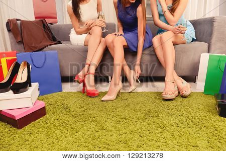 Close Up Photo Of Three Woman Doing Shopping In Mall
